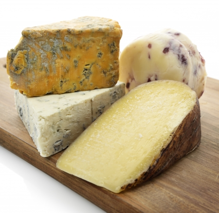 wedges: Gourmet Cheese Assortment On A Wooden Board  Stock Photo