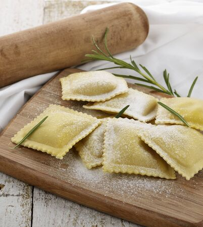 Homemade Ravioli On A Cutting Board photo