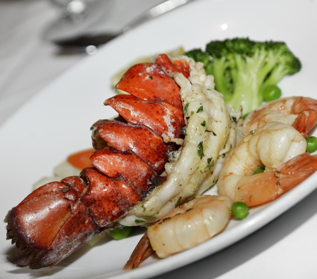 lobster tail: Lobster Tail And Shrimps With Vegetables Stock Photo