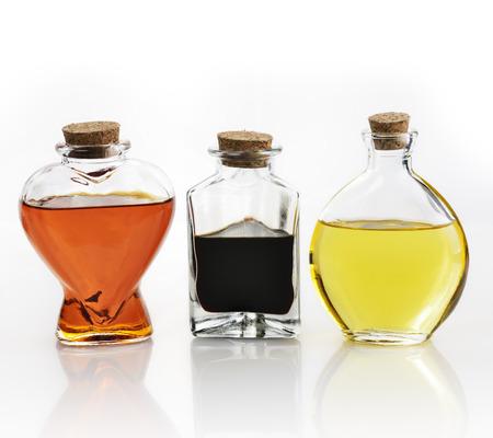 cooking oil: Glass Bottles Of Oil And Vinegar On White  Stock Photo
