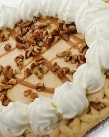 Pumpkin Pie With Whipped Cream Walnuts And Caramel Sauce photo