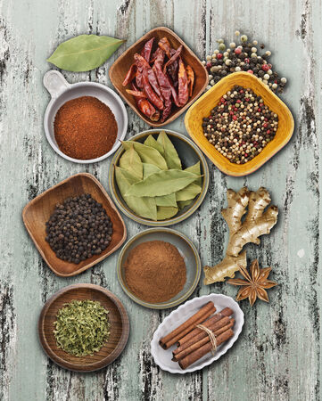 anice: Spices Collection On A Rusty Wooden Surface Stock Photo