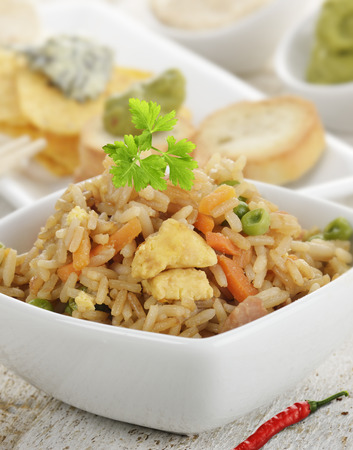 chicken rice: Rice With Chicken And Vegetables In A White Bowl Stock Photo