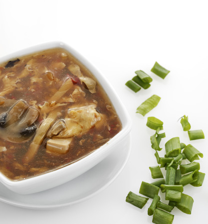 hot soup: Hot and Sour Soup In A White Bowl