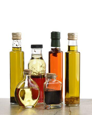 vinegar bottle: Glass Bottles Of Olive Oil,Salad Dressing And Vinegar Stock Photo