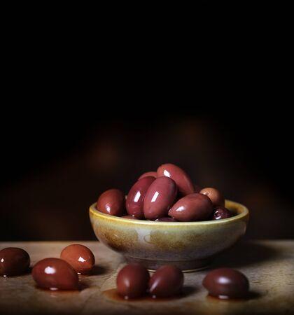 kalamata: Kalamata Olives In Ceramic Bowl Stock Photo