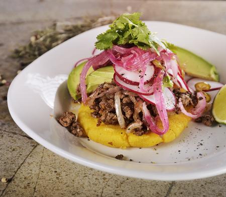 red jalapeno: Arepas, Fried Cornmeal Patties,with Ground Beef,Avocado,Red Onions and Jalapeno