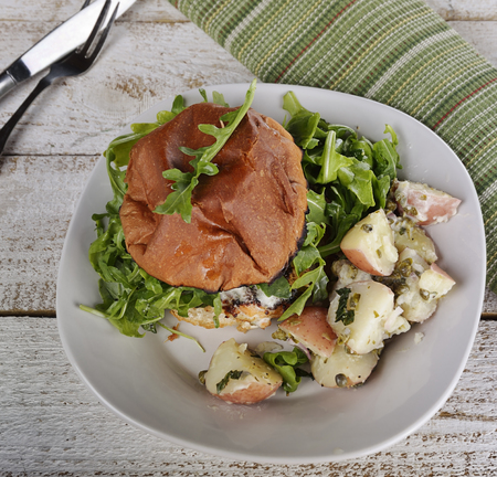 Salmon Burger With Arugula And Potato Salad Imagens - 43211882