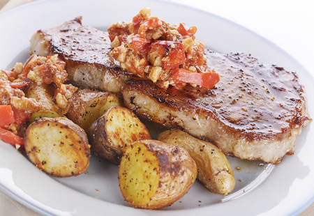 fingerling: Seared Loin Steak with Fingerling Potatoes and Romesco Sauce Stock Photo
