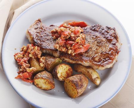 Seared Loin Steak with Fingerling Potatoes and Romesco Sauce Фото со стока