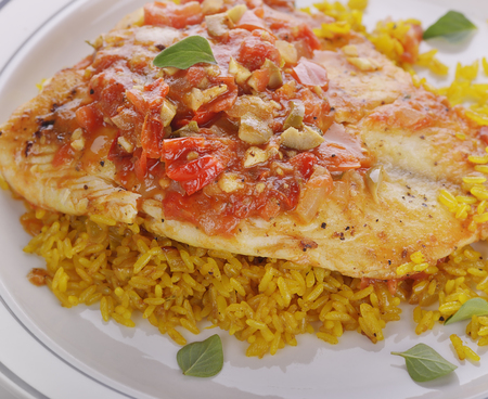 Tilapia Fillets with Yellow Rice and Vegetables