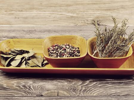 dried herbs: Dried Herbs and Spices in Wooden Dish Stock Photo