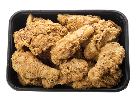 lunch tray: Close up of fried chicken in a plastic container isolated on white