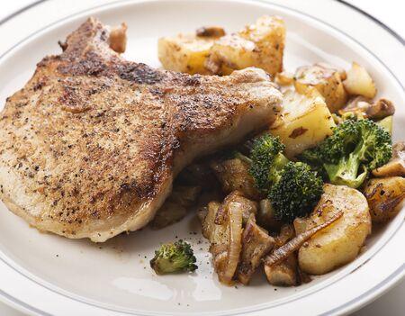 pork chops: pork chops with potatoes broccoli and onions