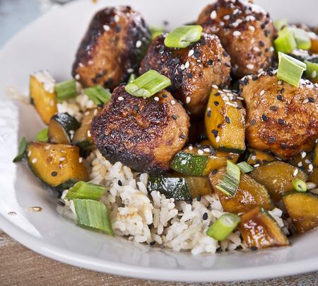 Meatballs with rice and zucchini, close up Фото со стока
