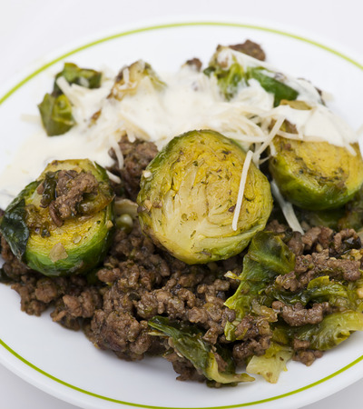 Brussels sprouts and beef close up on white background 스톡 콘텐츠