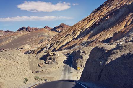 Desert road leading through Death Valley National Park, California USA.Artist's Palette scenic drive.