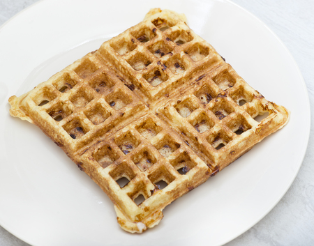 Homemade square belgian waffle  on a white plate
