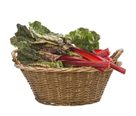 Fresh swiss chard in a basket , isolated on white background Stock Photo