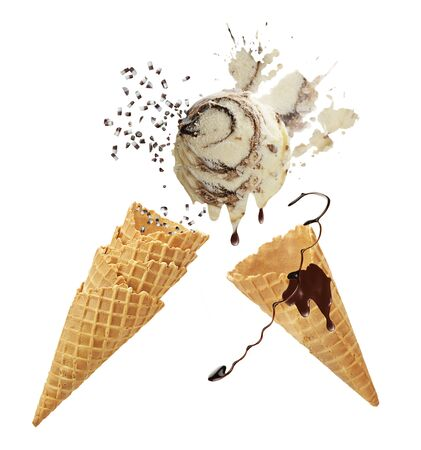 Vanilla and chocolate ice cream with waffle cones isolated on white background.