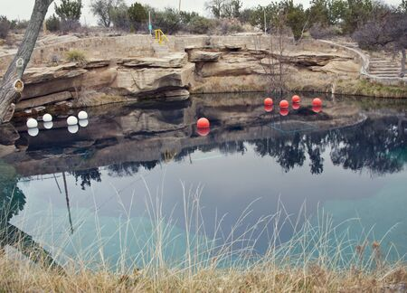 SANTA ROSA, NM, USA - March 11 ,2019. At 80 feet deep with clear blue water, the Blue Hole on Route 66 in Santa Rosa, NM. The Blue Hole of Santa Rosa is a circular, bell-shaped pool east of Santa Rosa