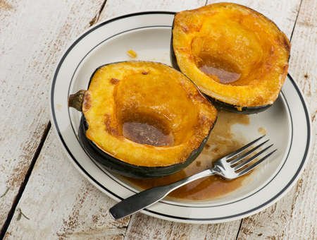 Acorn Squash Cooked With Brown Sugar And Butter in a plate