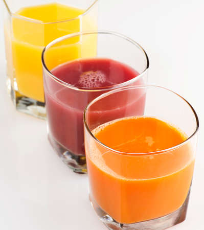 Fresh Fruit And Vegetable Juice on White background 写真素材