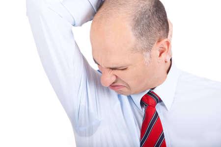 Business man notices a wet armpit