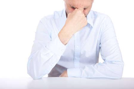 A studio shot of a man suffering
