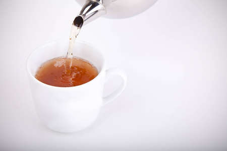 Pouring some tea Stock Photo