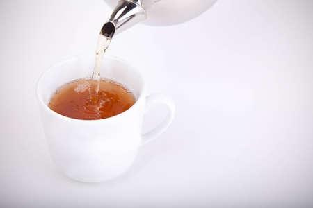 Pouring some tea Stock Photo