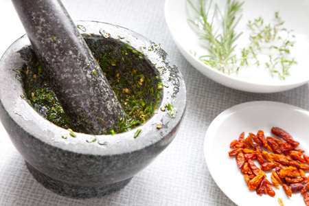 A close up shot of a mortar and a pestle