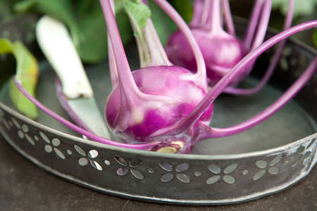 outdoor shot of some fresh cabbage of kohlrabi on a vintage tray Stock Photo