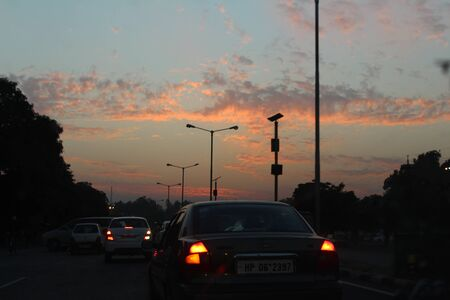 capturing: capturing sun set during travel and sitting in the car Editorial