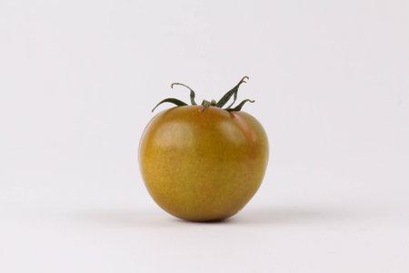 Green Tomatoes On White Background Stock Photo