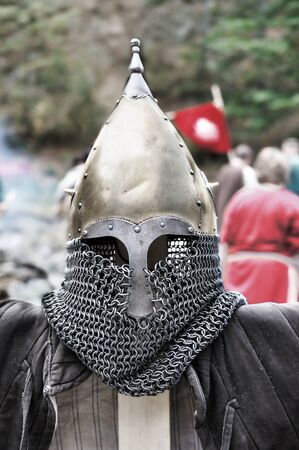 Medieval Templar helmet waiting for its knight photo