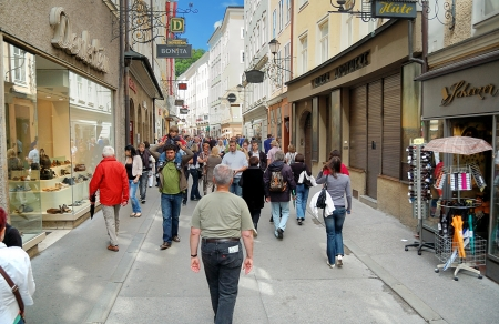 amadeus mozart: SLAZBURG, AUSTRIA -JUNE 12  June  View of famous Getreidegasse from Salzburg, Austria  Currently a lively shopping area  Wolfgang Amadeus Mozart was born and grew up in house next to Getreidegasse  12,2011 in Salzburg, Austria
