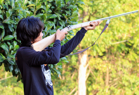 shootings: Hunter aiming and ready for shoot wild birds hunting Stock Photo