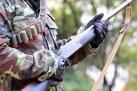 sniper training: A man in soldier suit with rifle and bullets Stock Photo