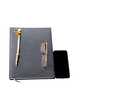 log book: The log book and glasses with smart phone on white background