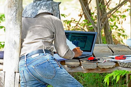 surveying: People are working surveying land