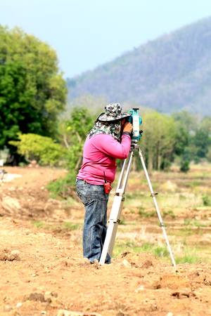 People are working surveying land