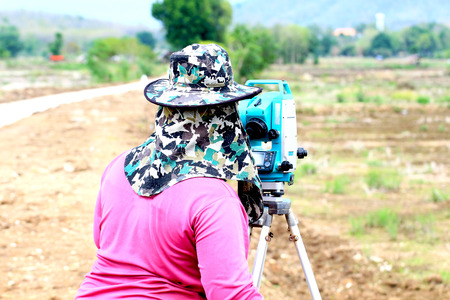 land surveying: People are working surveying land