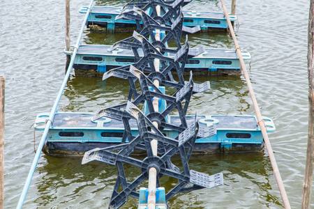 aerator: At shrimps pond in the rainy season,and paddle wheel aerator in Thailand Stock Photo
