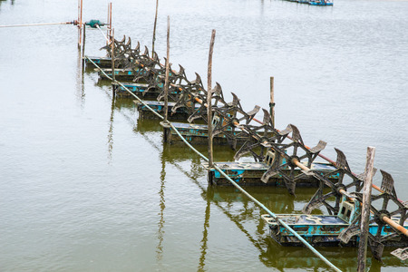 paddle wheel: At shrimps pond in the rainy season,and paddle wheel aerator in Thailand Stock Photo