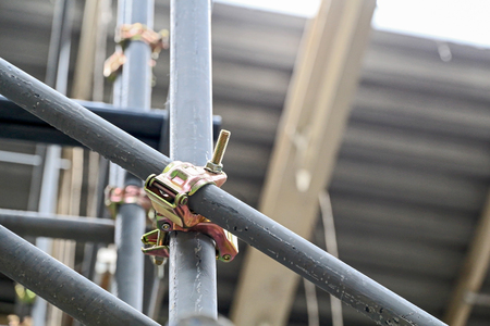 clamped: Scaffolding pipe clamp and parts, An important part of building strength to scaffold.