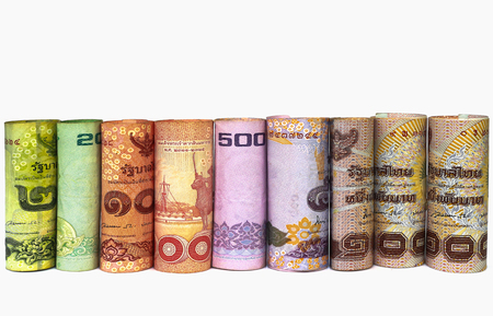 money roll: Roll thai money banknotes on white background