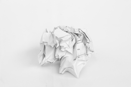 script writing: Crumpled sheet of free hand script writing paper on white background