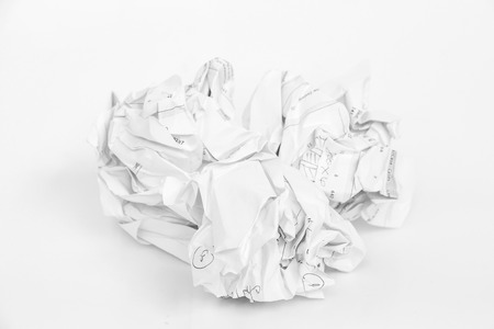 Crumpled sheet of free hand script writing paper on white background