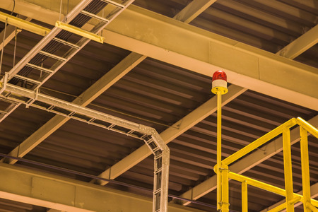 flashing: flashing light on upstairs under yellow light in factory,siren Stock Photo